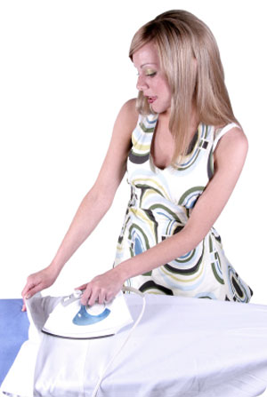 a girl ironing at home